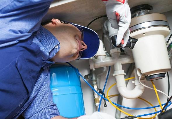 Nyc Plumbers Fixing Garbage Disposal